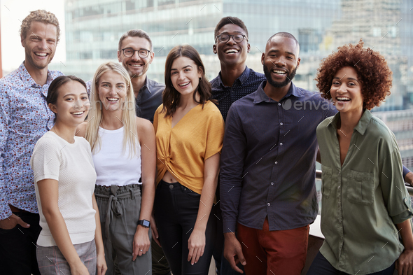 Group portrait of a creative business team standing outdoors, three quarter length, close up - Stock Photo - Images