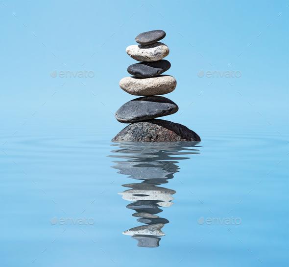 Zen balanced stones stack in lake balance peace silence concept ...