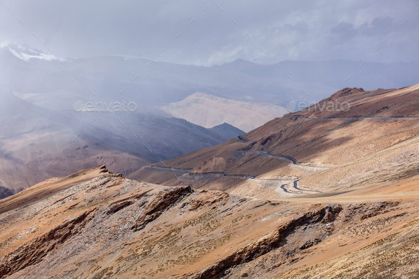 Road in Himalayas with mountains - Stock Photo - Images
