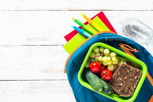 Back to school concept. Lunch box with stationery and backpack - Stock Photo - Images