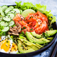 Salmon poke bowl served with avocado, eggs, cucumber and greens - PhotoDune Item for Sale
