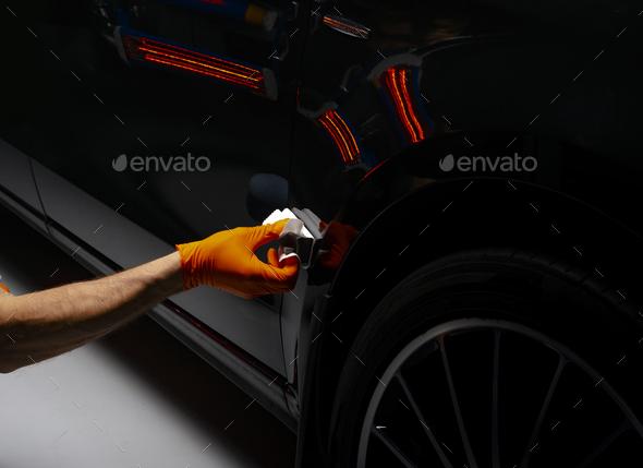 Car polish wax worker hands polishing car - Stock Photo - Images