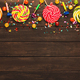 Colorful border of spiral lollipops on wooden background - PhotoDune Item for Sale