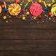 Colorful border of spiral lollipops on wooden background - PhotoDune Item for Sale