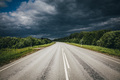 Dark Storm clouds over a highway - PhotoDune Item for Sale