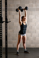 Fit strong woman doing weightlifting exercises - PhotoDune Item for Sale