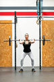 Young woman doing a front squat in a gym - PhotoDune Item for Sale