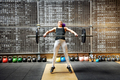 Young woman doing the snatch with a barbell - PhotoDune Item for Sale