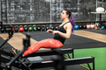 Fit woman athlete working out on a rowing machine - PhotoDune Item for Sale