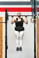 Athlete doing weighted pull-ups on a bar - PhotoDune Item for Sale