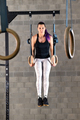 Young woman doing muscle up exercises on rings - PhotoDune Item for Sale