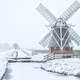 Dutch windmill in white winter snow - PhotoDune Item for Sale