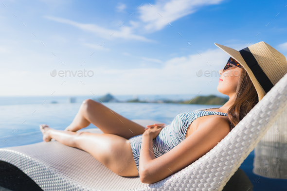 Portrait beautiful young asian woman smile happy relax around sw - Stock Photo - Images
