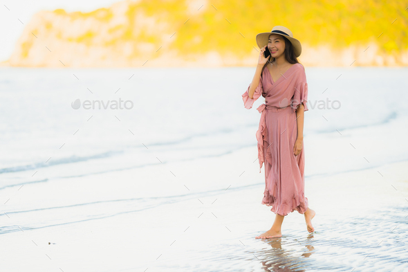 Portrait beautiful young asian woman smile happy walk with talki - Stock Photo - Images