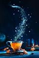 Sugar nebula creative food photo. Teacup with falling sugar forming Milky Way galaxy. Conceptual - PhotoDune Item for Sale