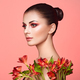 Portrait of beautiful young woman with Alstroemeria flowers - PhotoDune Item for Sale