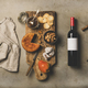 Wine bottle, vintage corkscrews, linen towel and appetizers board - PhotoDune Item for Sale
