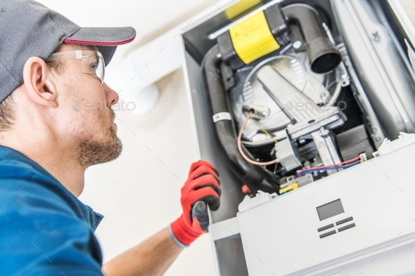 Technician and the Heater Issue - Stock Photo - Images
