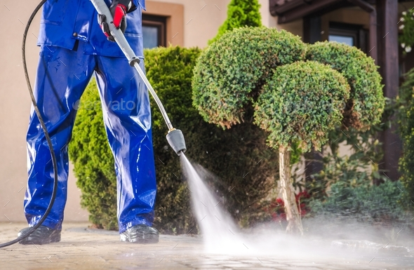 Cleaning Residential Driveway - Stock Photo - Images