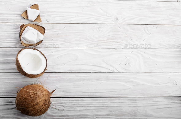Flat lay background of coconut, coconut shell and meat pieces on - Stock Photo - Images