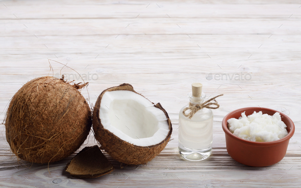 Background of coconut, coconut shell, oil in clay bowl and glass - Stock Photo - Images