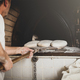 Production of baked bread with a wood oven in a bakery. - PhotoDune Item for Sale
