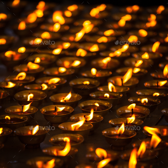 Burning candles in Buddhist temple. McLeod Ganj, Himachal Prades - Stock Photo - Images