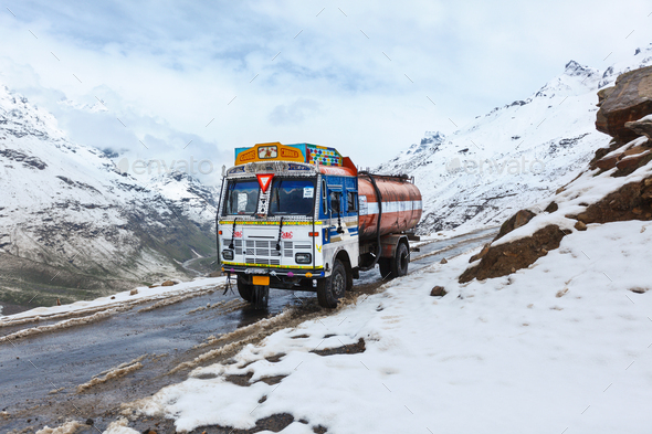 Manali-Leh road in Indian Himalayas with lorry - Stock Photo - Images