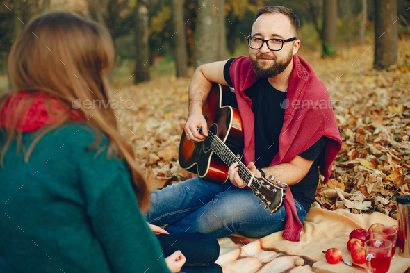 Elegant couple spend time in a autumn park - Stock Photo - Images