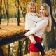 Cute and stylish family in a autumn park - PhotoDune Item for Sale