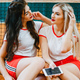 Beautiful and stylish girls on the tennis court - PhotoDune Item for Sale
