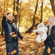 Family with daughter in a autumn park - PhotoDune Item for Sale