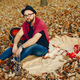 Handsome man sitting in a autumn park - PhotoDune Item for Sale