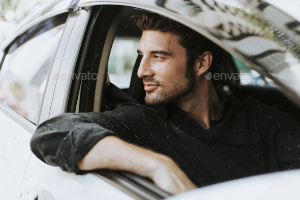 Handsome man in a car - Stock Photo - Images