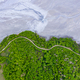 Aerial drone image of forest road and flooding mining residuals - PhotoDune Item for Sale