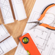 Electrical blueprints or diagrams and orange work tools for use in engineer jobs - PhotoDune Item for Sale
