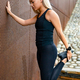 Fit athlete woman stretching after workout against metal wall in the city - PhotoDune Item for Sale