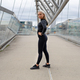 Fit Female Beauty in Black Workout Wear Standing At Modern Bridge In City - PhotoDune Item for Sale