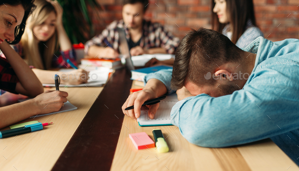 Group of tired students prepares for exams - Stock Photo - Images