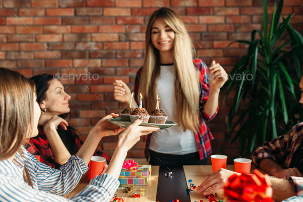 Female university student gets a sweet gift - Stock Photo - Images