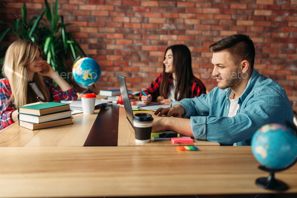 Group of students studying at the table together - Stock Photo - Images