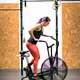Woman athlete working out on an exercise bike - PhotoDune Item for Sale