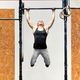 Young girl athlete doing pull-ups on a bar - PhotoDune Item for Sale