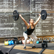 Young woman performing the snatch in a gym - PhotoDune Item for Sale