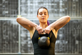 Girl working out with a kettlebell weight - PhotoDune Item for Sale