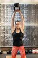 Fit young athlete training with a kettlebell - PhotoDune Item for Sale