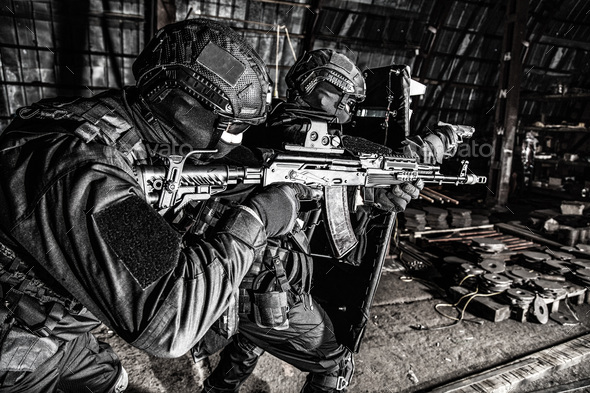 Police special reaction team squad attacking criminals - Stock Photo - Images