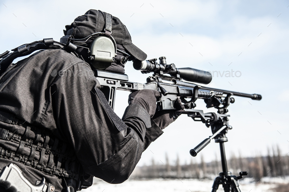 Equipped police SWAT sniper shooting with rifle - Stock Photo - Images