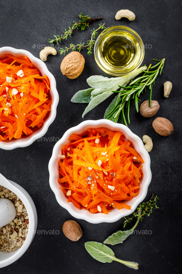Fresh carrot salad with oil and nuts - Stock Photo - Images
