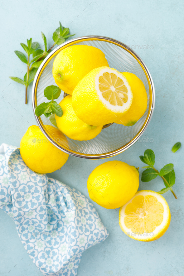 Sliced and whole lemons with mint - Stock Photo - Images